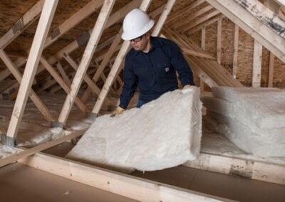 Austin Company | installation of white fiberglass in residential attic