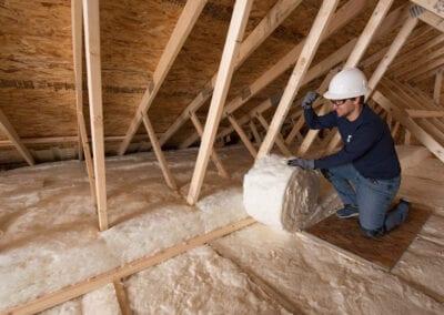 Austin Company | installing fiberglass in attic of home